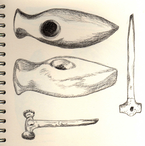 Neolithic axeheads and pins sketched at Tullie House